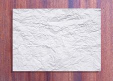 Free White Crumpled Paper On Wood Stock Photo - 16164680