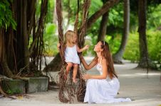 Free Mother And Her Little Daughter In Tropical Park Royalty Free Stock Images - 16169499