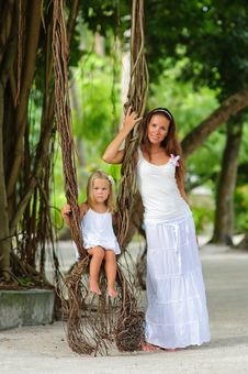 Free Young Mother And Her Daughter In Tropical Park Stock Image - 16169511