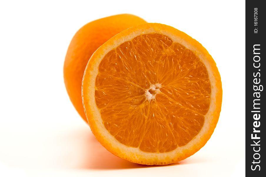 One half of orange with another whole orange.
