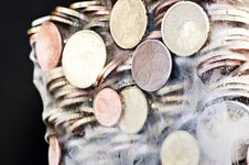 Shiny Euro Coins Frozen In Ice Royalty Free Stock Image