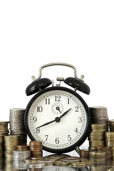 Free TIME IS MONEY Concept: Alarm Clock And Euro Coins Stock Images - 16172214