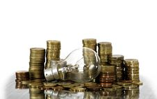 Free Filament Bulb Lying On Coins Royalty Free Stock Photography - 16172267