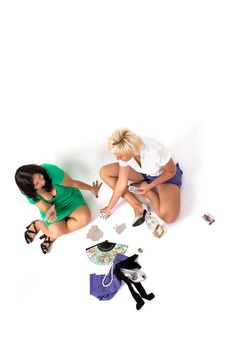 Pair Of Women Play Cards, Drink Alcohol Royalty Free Stock Photography