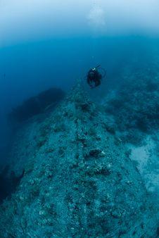 Female Scuba Diver Exploring Ship Wreck Royalty Free Stock Photo