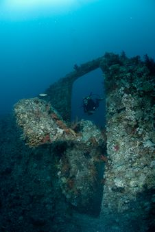 Female Scuba Diver Exploring Ship Wreck Royalty Free Stock Images