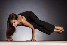 Free Woman In Sideways Crow Pose (Ashtavakrasana) Stock Photo - 16175290