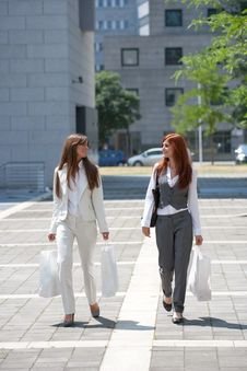 Free Two Young Woman With Shopping Bags Outdoors Stock Photo - 16177670