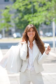 Young Woman With Shopping Bag And Credit Card Royalty Free Stock Images