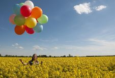 Girl With Colorful Balloons Royalty Free Stock Photography