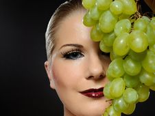 Beautiful Woman With White Grapes Stock Image