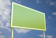 Free Green Sign In Front Of A Blue Sky Stock Images - 16189344