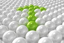 White 3D Balls With Green Ones Forming An Arrow Stock Photos