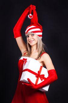 Free Santa Girl Holding A Great Gift. Stock Photo - 16190310