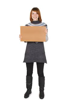 Free Girl Standing And Holding Cardboard Stock Images - 16191414