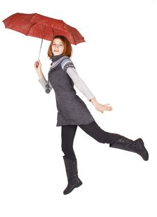 Girl Holding Red Umbrella And Jumping Stock Image
