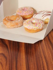 Box Of Doughnuts On An Office Desk Stock Photo