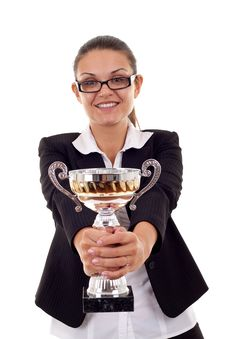 Woman Handing Out A Gold Trophy Stock Photo