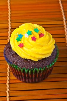 Free Yellow Vanilla Cupcake With Confetti Stars Stock Image - 16193941