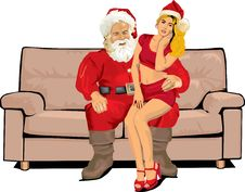 Santa Claus And Sexy Santa Helper Royalty Free Stock Image