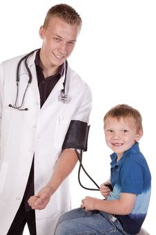 Free Doctor Making Boy Happy Stock Image - 16195091