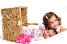 Free Two Sisters Playing And Smiling In A Basket Royalty Free Stock Image - 16195716