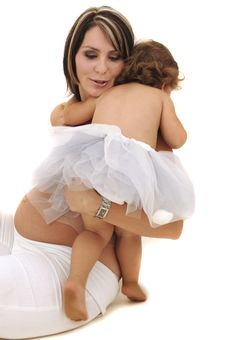 Pregnant Topless Mother Playing With Her Infant Stock Photo