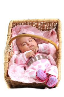 Free Baby Girl In Pink Laying In A Brown Basket Royalty Free Stock Image - 16195826
