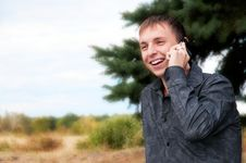 Free Young Guy Talking On Cellphone Royalty Free Stock Photography - 16196287