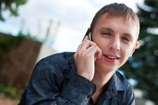 Free Smiling Guy Talking On Cellphone Stock Photo - 16196320