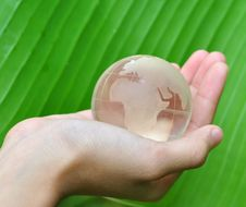 Free Glass Globe In Hand Royalty Free Stock Photos - 16199018