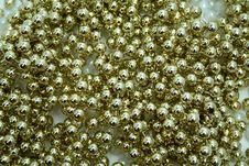 Celebratory Brilliant Beads Of Golden Color Royalty Free Stock Photography