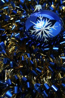 Christmas Glass Sphere On A Celebratory Tinsel Royalty Free Stock Photography