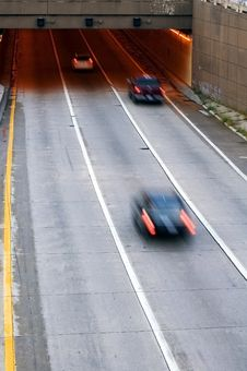 Cars Speed Into Tunnel With Motion Blur Royalty Free Stock Photography