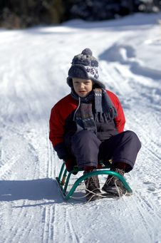 Boy On Sled Royalty Free Stock Photo