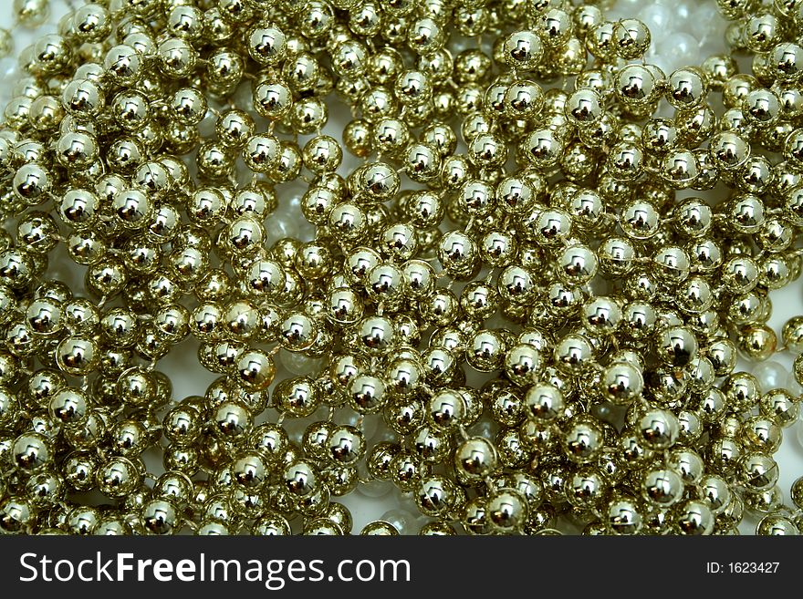 Celebratory brilliant beads of golden color