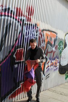 Free Man Near Graffity Wall Stock Images - 16200314