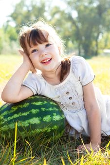 Free A Little Girl Lies On Watermelon Royalty Free Stock Image - 16206666
