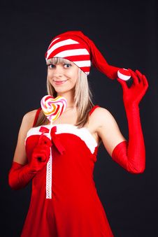 Free Santa Girl Holding A Lollipop. Stock Photos - 16207003