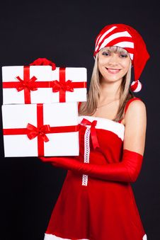 Free Santa Girl Holding The Box With Gifts. Royalty Free Stock Images - 16207029
