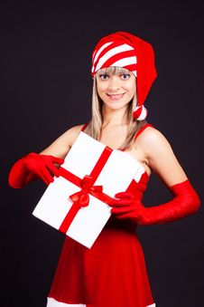 Free Santa Girl Holding The Box With Gifts. Stock Photography - 16207052