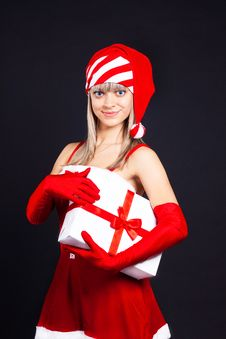 Free Santa Girl Holding The Box With Gifts. Stock Photography - 16207092