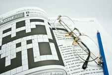 Eyeglass On Crossword Book Royalty Free Stock Images