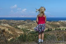 Girl Looks At The Sea, Beach And Mountains Royalty Free Stock Images