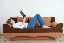 Free Woman With Laptop On The Sofa Stock Photos - 16216103