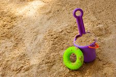 Toys In The Sand Stock Photo