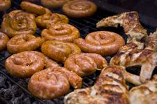 Free Grilled Sausages And Chicken Wings Stock Photo - 16218410