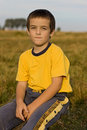 Free Boy Sitting On The Grass Royalty Free Stock Photos - 16226368