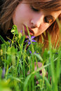 Free Girl Bent Over To The Flower Royalty Free Stock Image - 16228426
