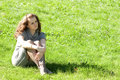 Free Girl Sitting On Green Grass Royalty Free Stock Photography - 16229827
